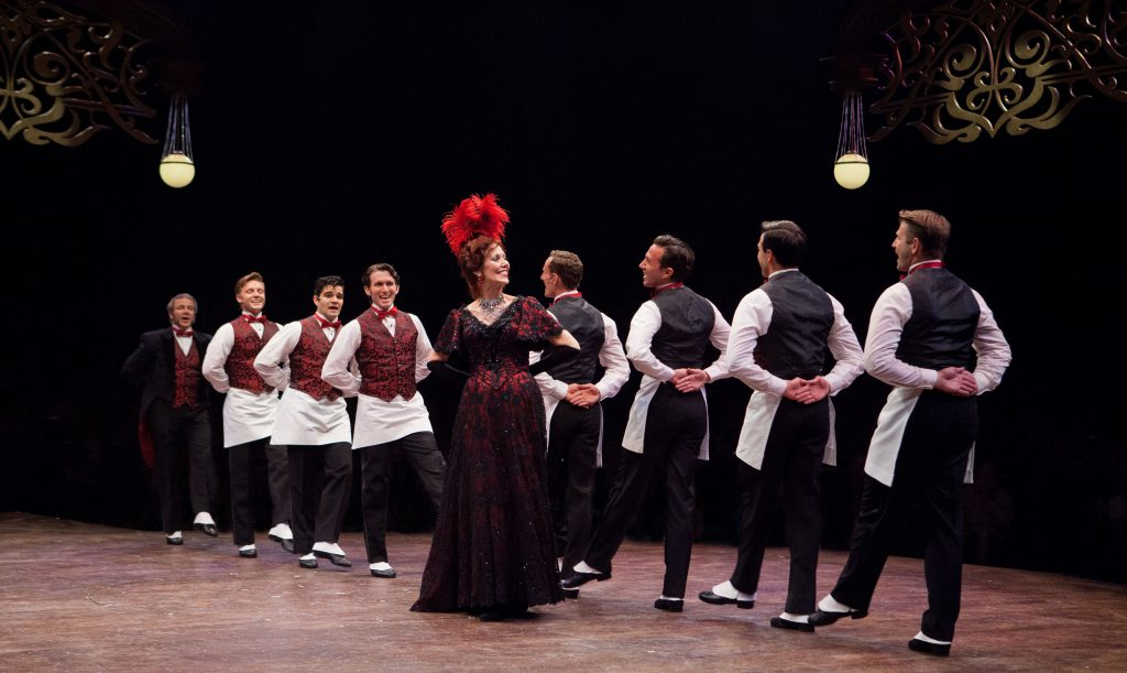 Lynne Wintersteller as Dolly Levi (center) and the company of Hello, Dolly!, produced by Music Circus at the Wells Fargo Pavilion in 2016. Photo by Kevin Graft.
