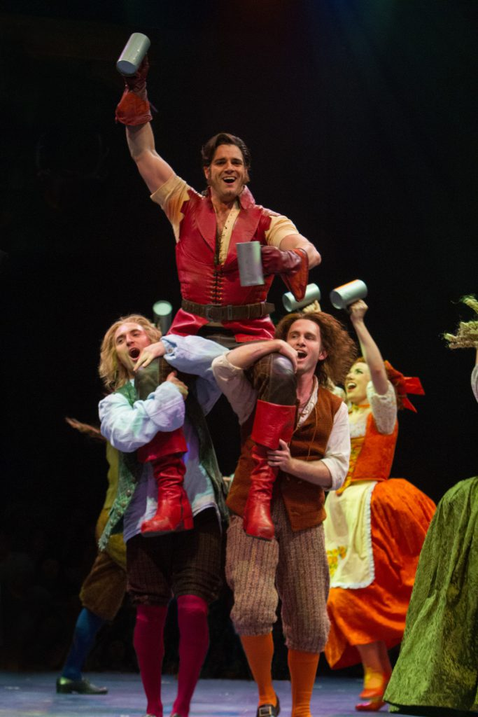 Peter Saide as Gaston and the company of Disney's Beauty and the Beast, produced by Music Circus at
