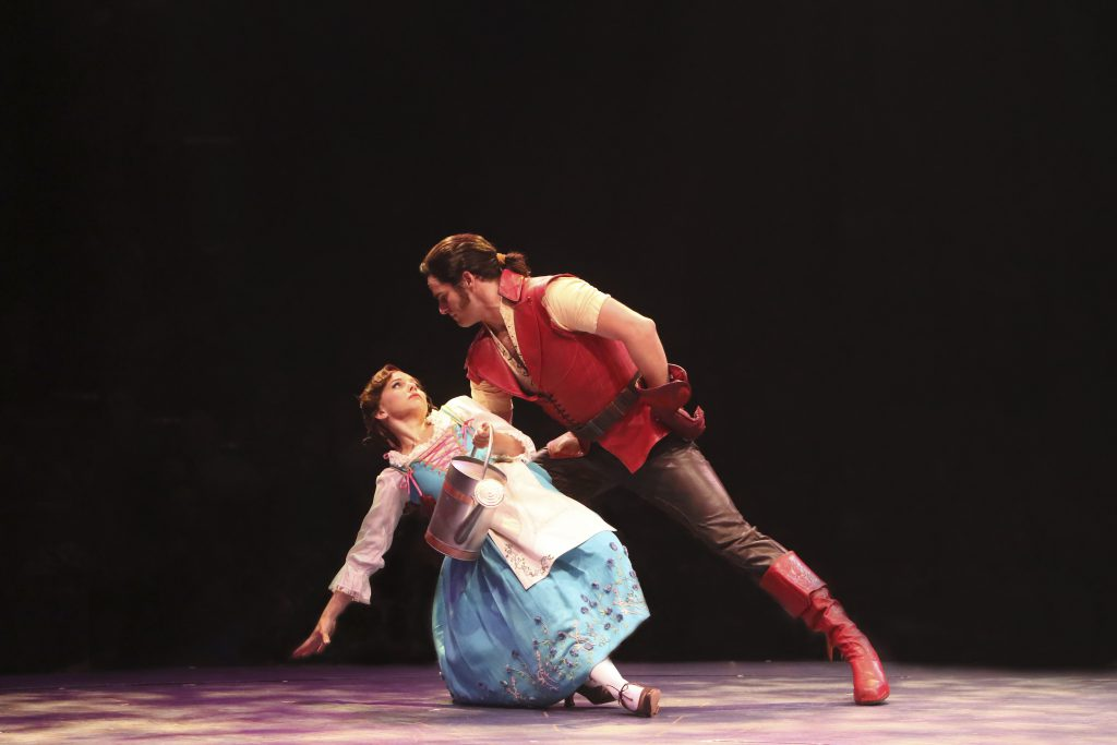 Jessica Grové as Belle and Peter Saide as Gaston in Disney's Beauty and the Beast, produced by Music