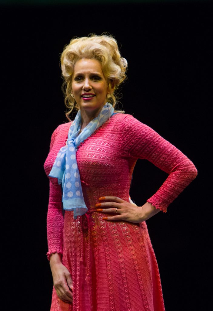 Tricia Paoluccio as Doralee Rhodes and company in 9 to 5, The Musical produced by Music Circus at th