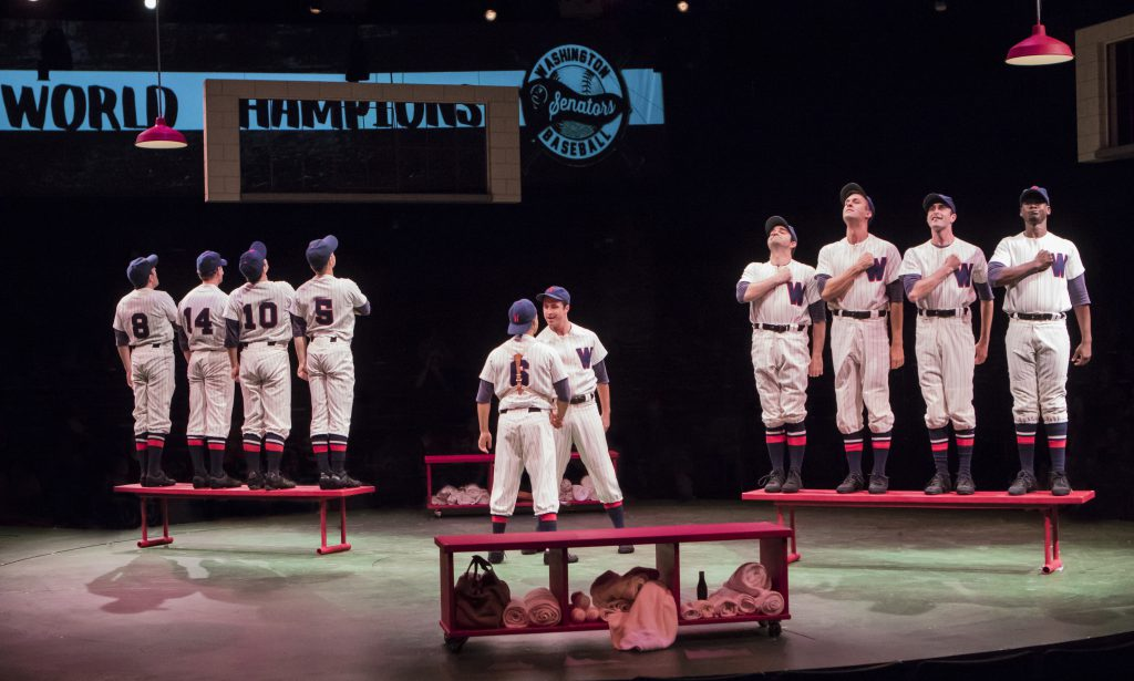 Justin Keyes as Smokey, Dallas Padoven as Rocky and the company of Damn Yankees produced by Music Circus at the Wells Fargo Pavilion in 2017. Photo by Charr Crail.