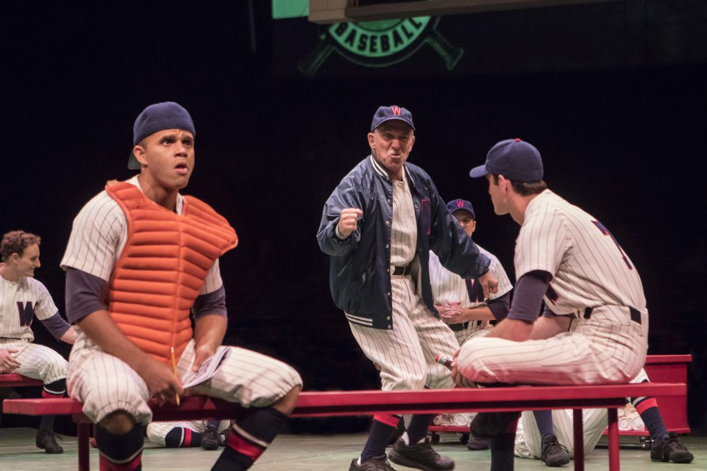 Justin Keyes as Smokey, Stephen Berger as Van Buren and the company of Damn Yankees produced by Musi