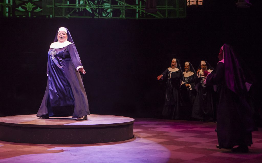 Nikki Switzer as Mary Patrick and the company of Sister Act produced by Music Circus at the Wells Fa