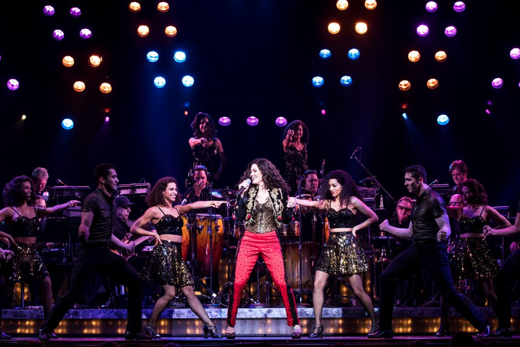 Christie Prades as Gloria Estefan and the company of the Broadway On Tour presentation of ON YOUR FEET! Oct. 30 – Nov. 4, 2018 at the Sacramento Community Center Theater. Photo by Matthew Murphy.