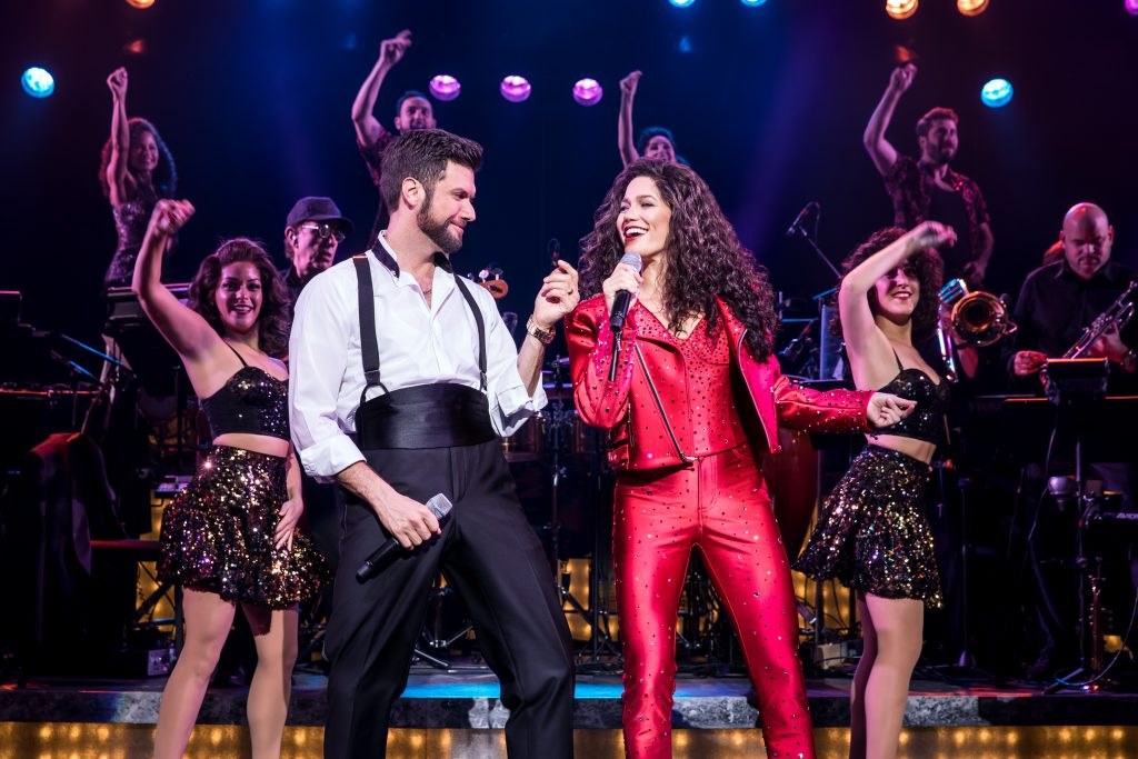 Mauricio Martinez as Emilio Estefan and Christie Prades as Gloria Estefan and the company of the Broadway On Tour presentation of ON YOUR FEET! Oct. 30 – Nov. 4, 2018 at the Sacramento Community Center Theater. Photo by Matthew Murphy.