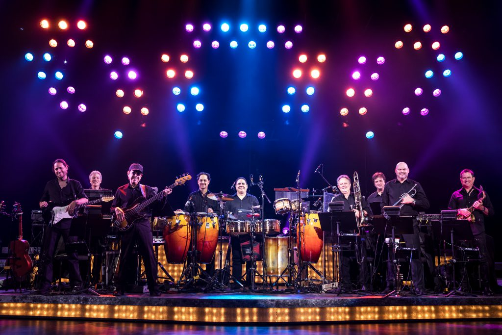 ON YOUR FEET! band featuring members of the Miami Sound Machine: Clay Ostwald (Music Director/Keyboard), Jorge Casas (bass), Edward Bonilla (percussion) and Theodore Mulet (trombone) in the Broadway On Tour presentation of ON YOUR FEET! Oct. 30 – Nov. 4, 2018 at the Sacramento Community Center Theater. Photo by Matthew Murphy.