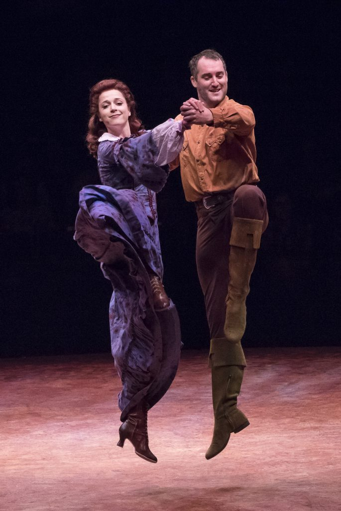 (from L to R) Paige Faure as Milly and Eric Stretch as Benjamin Pontipee in SEVEN BRIDES FOR SEVEN B