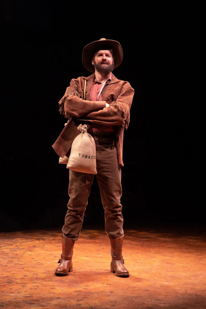 Edward Watts as Adam Pontipee in SEVEN BRIDES FOR SEVEN BROTHERS, produced by Broadway At Music Circ