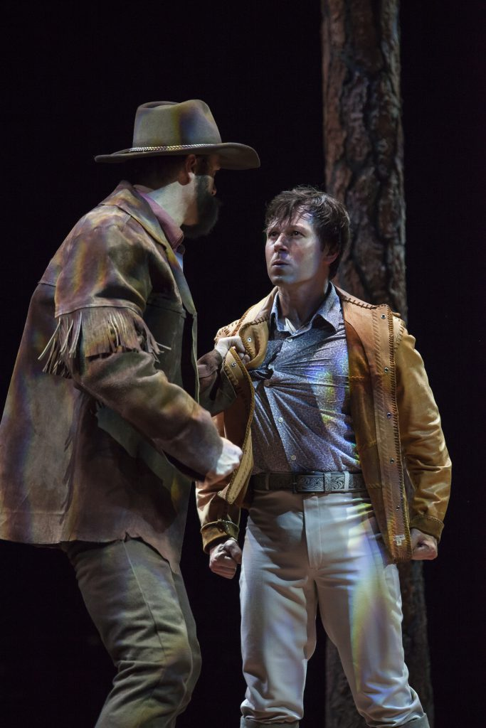 (from L to R) Edward Watts as Adam Pontipee and KC Fredericks as Gideon Pontipee in SEVEN BRIDES FOR