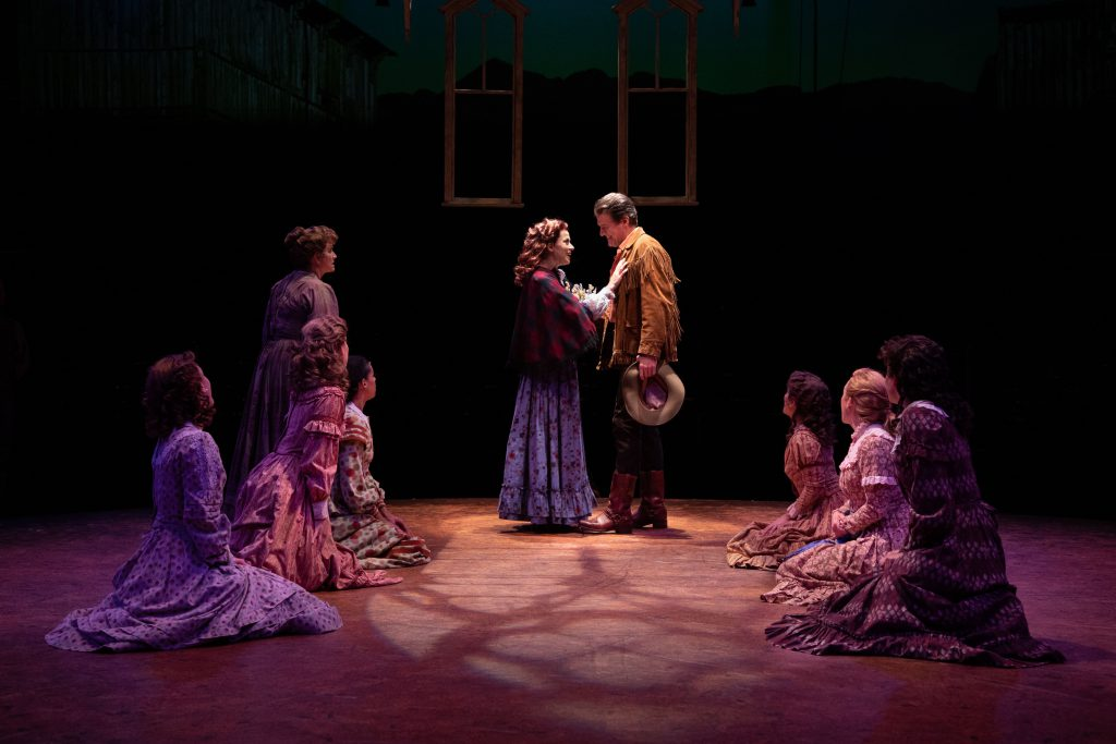 (from L to R) Diane Vincent as Mrs. Hoallum, Paige Faure as Milly, Edward Watts as Adam Pontipee and