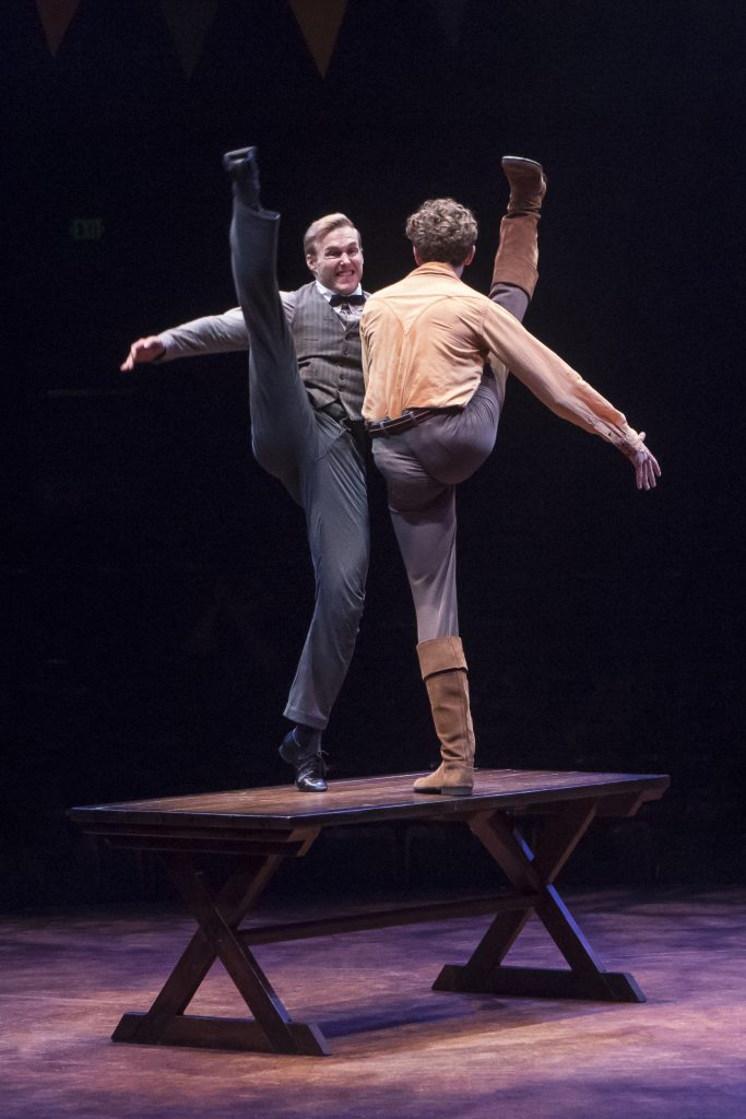 (from L to R) Cameron Edris as Jeb and Graham Keen as Caleb Pontipee in SEVEN BRIDES FOR SEVEN BROTH