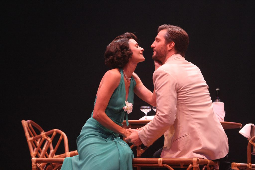 (L to R) Beth Malone (Ensign Nellie Forbush) and John Cudia (Emile de Becque) in South Pacific, produced by Music Circus at the Wells Fargo Pavilion in 2014. Photos by Charr Crail.