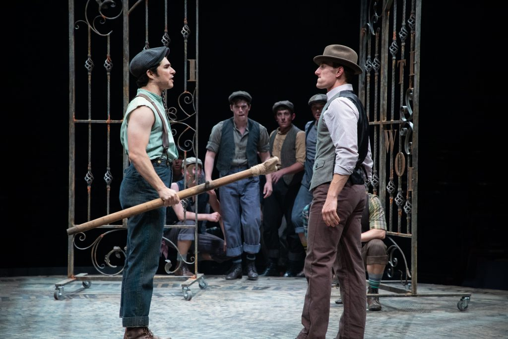 (from L to R) Joey Barreiro as Jack Kelly and Adam Lendermon as Oscar Delancey with the Company of D