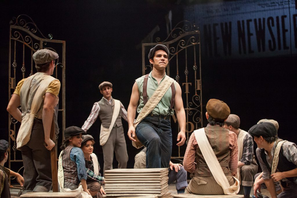 (center from L) John Krause as Davey and Joey Barreiro as Jack Kelly with the Company of DISNEY'S NE