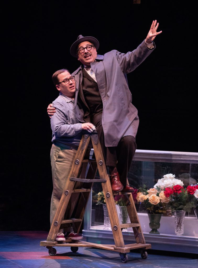 (left to right) Jared Gertner as Seymour and Michael Kostroff as Mushnik in LITTLE SHOP OF HORRORS p