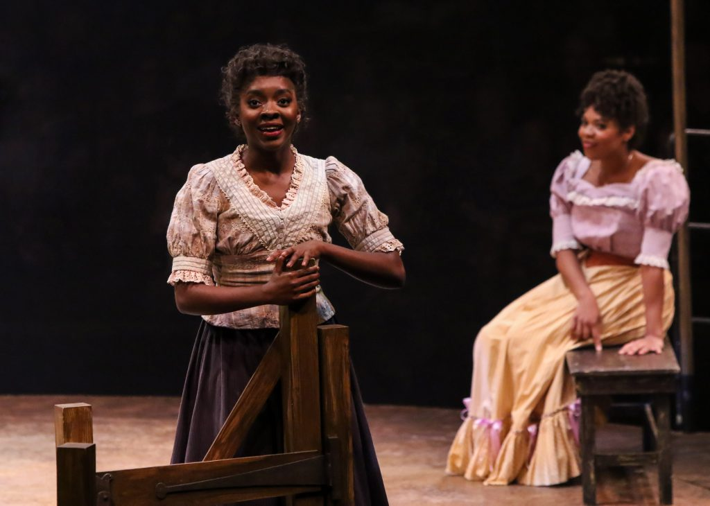 Emilie Kouatchou as Laurey Williams and Brit West as Ado Annie Carnes in OKLAHOMA! produced by Broadway At Music Circus at the Wells Fargo Pavilion June 25-30. Photo by Charr Crail.