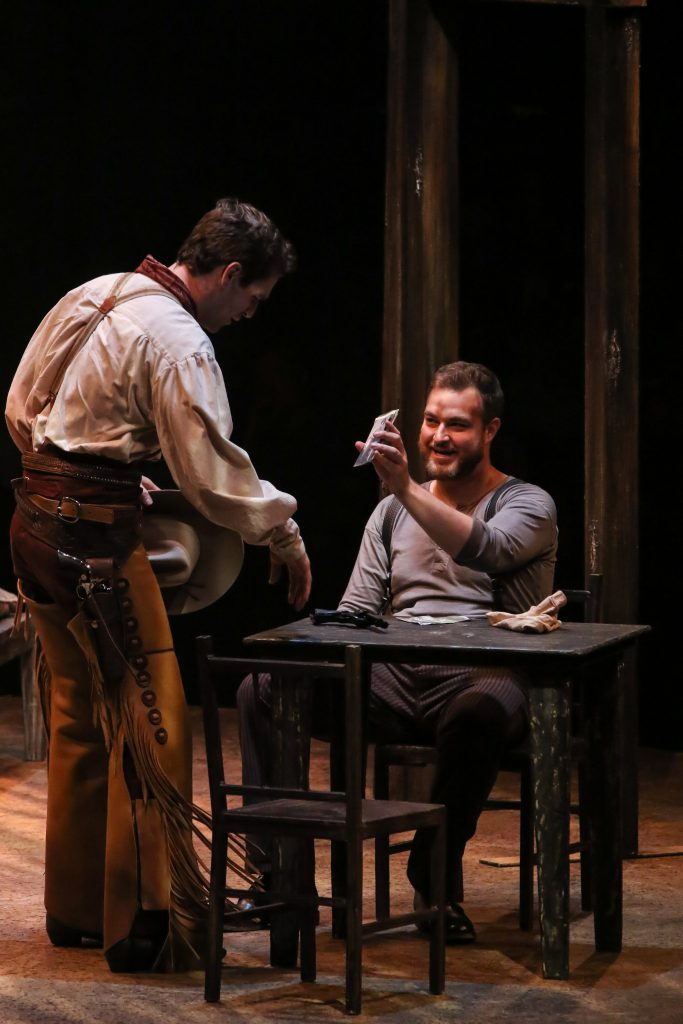 Ryan Vasquez as Curly McLain and John Rapson as Jud Fry in OKLAHOMA! produced by Broadway At Music Circus at the Wells Fargo Pavilion June 25-30. Photo by Charr Crail.