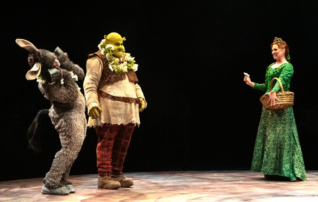 André Jordan as Donkey, Jacob Keith Watson as Shrek and Kristen Beth Williams as Princess Fiona in SHREK THE MUSICAL produced by Broadway At Music Circus at the Wells Fargo Pavilion June 11-16. Photo by Charr Crail.