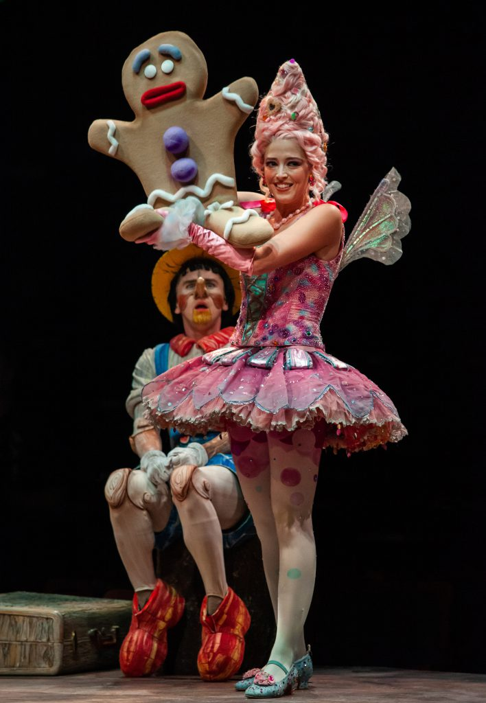 Tyler Jones as Pinocchio and Brittany Rose Hammond as Sugar Plum Fairy/Gingy, Gingy puppet by Richard Bay in SHREK THE MUSICAL produced by Broadway At Music Circus at the Wells Fargo Pavilion June 11-16.  Photo by Charr Crail.