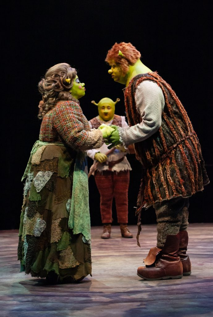 Jennifer Leigh Warren as Mama Ogre, Michael Stark as Young Shrek and Adam Rogers as Papa Ogre in SHREK THE MUSICAL produced by Broadway At Music Circus at the Wells Fargo Pavilion June 11-16. Photo by Charr Crail.