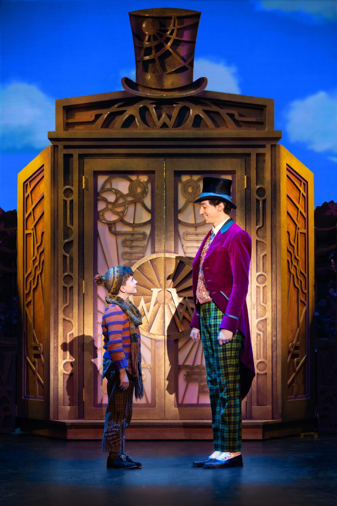 Ryan Umbarila as Charlie Bucket and Cody Garcia as Willy Wonka in Roald Dahl's CHARLIE AND THE CHOCOLATE FACTORY presented by Broadway On Tour December 28, 2021 – January 2, 2022 at the SAFE Credit Union Performing Arts Center. Photo by Jeremy Daniel.